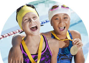 Two swimmers holding gold medals